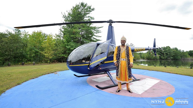 Indian groom arrives in a helicopter for his baraay