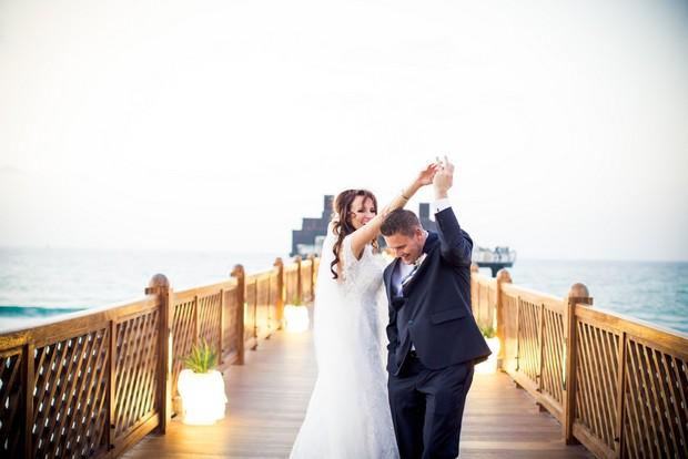 bride-groom-dancing-on-beach