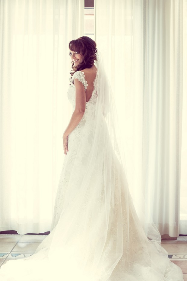 bride-in-handmade-wedding-dress-with-swarovski-crystals