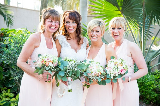 bride-with-bridesmaids-in-pink-dresses