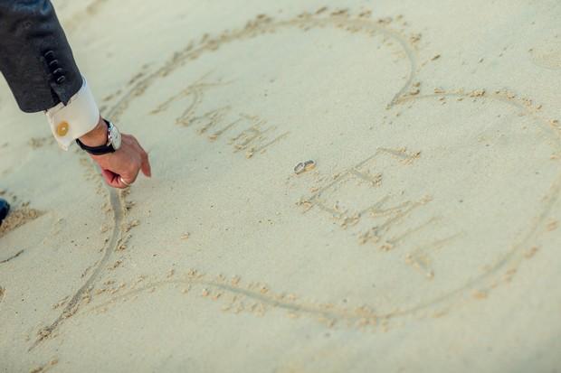 UAE_real_wedding_writing_in_sand