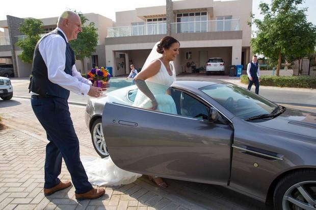 bride-getting-in-to-car-dubai-real-wedding