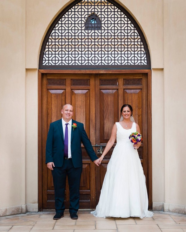dubai-real-wedding-bride-and-groom-holding-hands-outside-ceremony