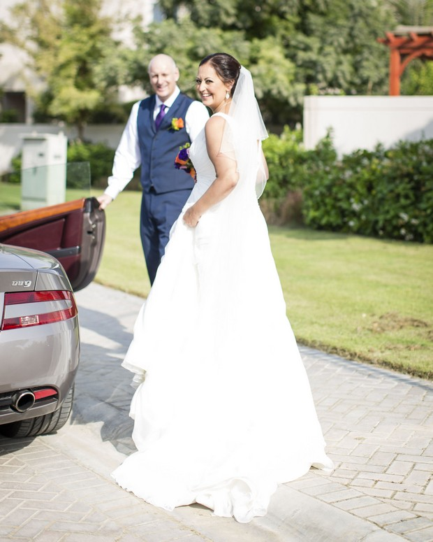 dubai-real-wedding-bride-getting-in-to-car