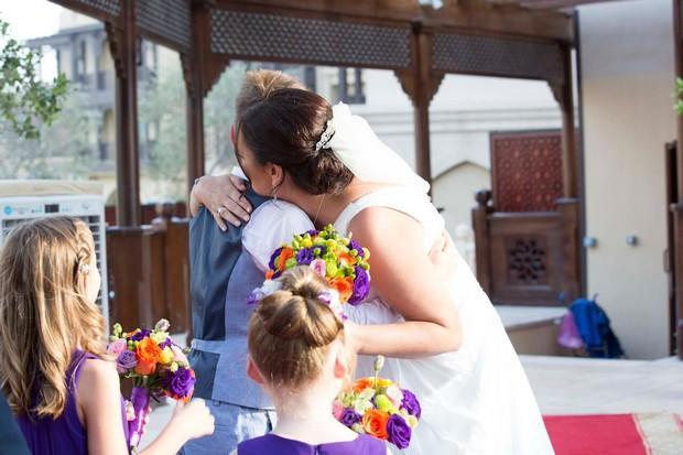 dubai-real-wedding-bride-hugging-her-child