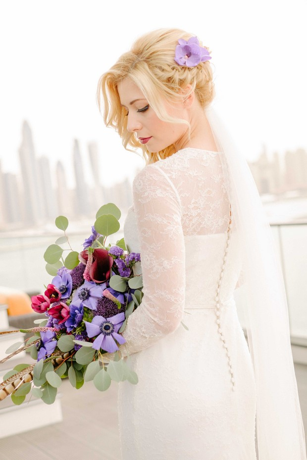 luxurious-wedding-photo-shoot-UAE-bride-with-hand-picked-purple-wildflower-bouquet