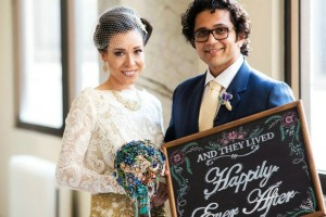 bride-and-groom-holding-happily-ever-after-wedding-sign